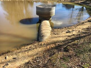 stormwater maintenance, stormwater control devices, stormwater device companies, fix stormwater drain, detwntion pond maintenance